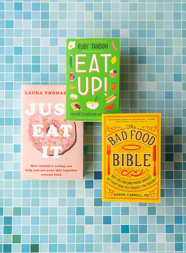 De drie boeken Just Eat It, Eat Up! en The Bad Food Bible samen op een blauw geblokte achtergrond.